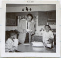 [Fred Cundiff with sons Fred Jr. and Roderick ]