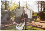 [Fred Cundiff in his back yard with dog]
