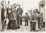 [Group of children watching a firefighting demonstration]