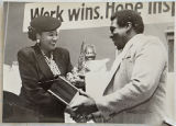 [Alma Adams receiving an award at a YMCA event]