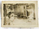[Woman in a lounge chair beside a travel trailer]