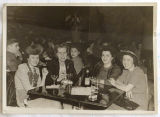 [Four women at a bar or nightclub]