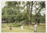 [Joe and Loretha Foushee playing badminton in the yard]