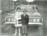[Dobeta Pressley and Mike Pressley in front of a 1960s car]