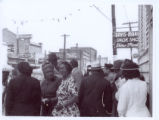 [Photograph of unidentified individuals on East Market Street, ca. 1960]