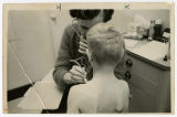 [Child receiving checkup]