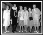 [Martha Blakeney Hodges with actor in costume and several unidentified women]