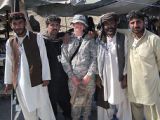 [Nicolle M. Brossard and Afghan men]