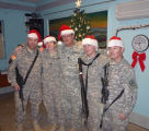 [Photograph of Melissa Culebth with four other soldiers at Christmas]