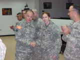[Photograph of Melissa Culbeth with Army Chief of chaplains on Thanksgiving Day in Baghdad]