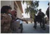 [United States Marines delivering a wheelchair, circa 2007-2008]