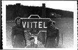 [WACs beside a road sign for Vittel, 1945]