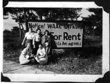 [WAACs in front of sign, circa 1943]