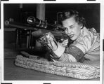 [Joan R. Kammer Horton with rifle, circa 1955]