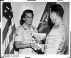 [Joan R. Kammer Horton receiving promotion, 1956]