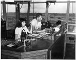 [Bobbi and Roger Earp in air traffic control tower, 1945]