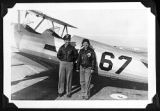 [Susie Winston Bain and pilot beside airplane, 1944]