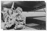 [June Neely Baker and coworker under airplane, circa 1943]
