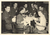 [WACs and airmen at NCO club, circa 1950]