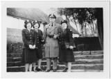 [Three army nurses and a serviceman in England, circa 1945]