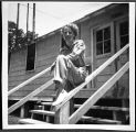 [Betty Pegg Hemphill on railing at Keesler AFB, circa 1951]