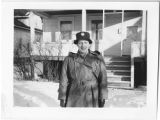 [Marcelle Fisher in front of a house, circa 1943]
