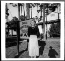 [Betty Pegg Hemphill beside sign at Keesler AFB, circa 1950]