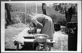[Frances Bradsher Turner washing her hair, circa 1951]