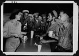 [Daisy Pickman serves servicemen at Red Cross canteen, 1945]