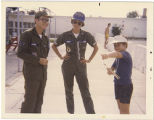 [Barbara W. Kucharczyk with serviceman and child, 1978]