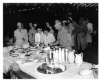 [Servicemen and women in line at a buffet, 1945]