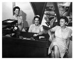 [Three ANC nurses at a desk, circa 1945]