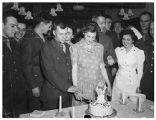 [A couple cut their wedding cake, circa 1944]