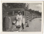 [Elsie Seetoo posing on charcoal truck, 1942]