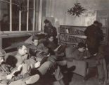 [Servicemen read in a lounge, circa 1945]