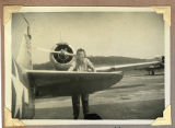 [Member of WAVES and a North American T-6 Texan SNJ-5 aircraft, circa 1944]