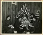 [WAVES members opening Christmas gifts, 1944]
