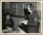 "[Marian ""Mac"" McBurney Kilgore playing bingo with friends, November 1943]"