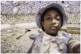 [Ingrid Ruffin under desert camouflage netting, 2003]