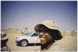 [Ingrid Ruffin walking at desert military camp, 2003]