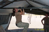 [Female airman doing a pull-up, 2003 ]