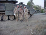 [Four female airmen by tank in Iraq, 2003]