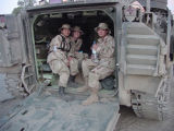 [Three female airmen in tank, circa 2003]
