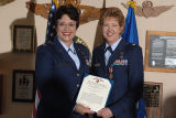 [Kathryn Wirkus holds Meritorious Service medal citation, circa 2005]