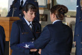 [Female officers perform the flag folding ceremony, circa 2005]