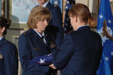 [Elizabeth Orie and Therese Robinson in flag folding ceremony, circa 2005]