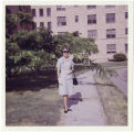 [Alice Park Fairbrother in front of Base Officer's Quarters, circa 1966]