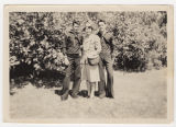 [Idelle Singletary with unidentified sailors]