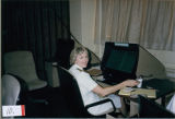 [Gayle Lewis works with computer, 1985]