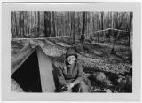 [Therese M. Lambert poses by tent, 1951]